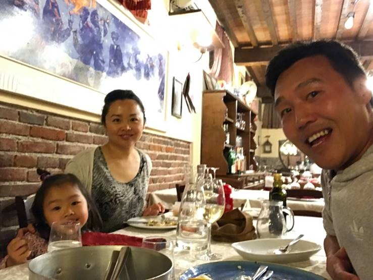 Jess and family in restaurant